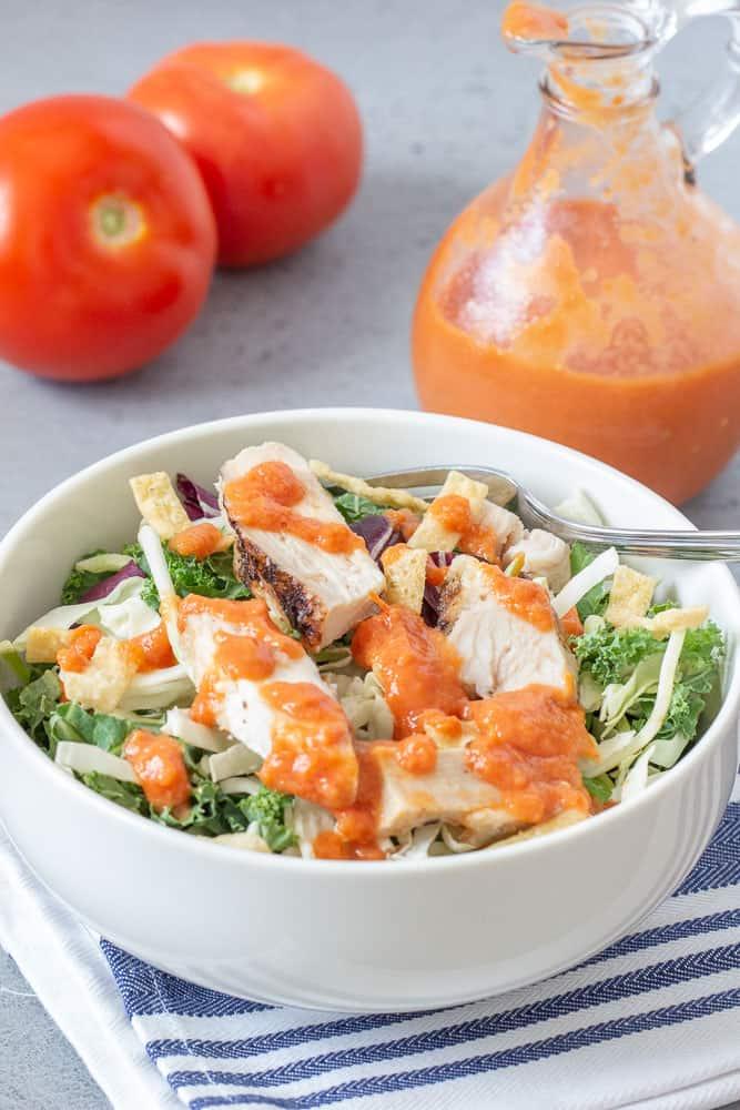 Roasted tomato salad dressing on salad