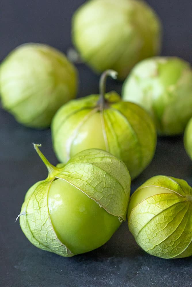 Tomatillos on black background