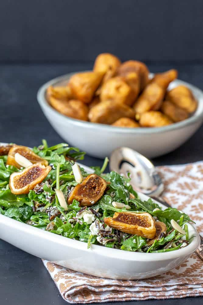 Salad with dried figs, bowl of figs behind