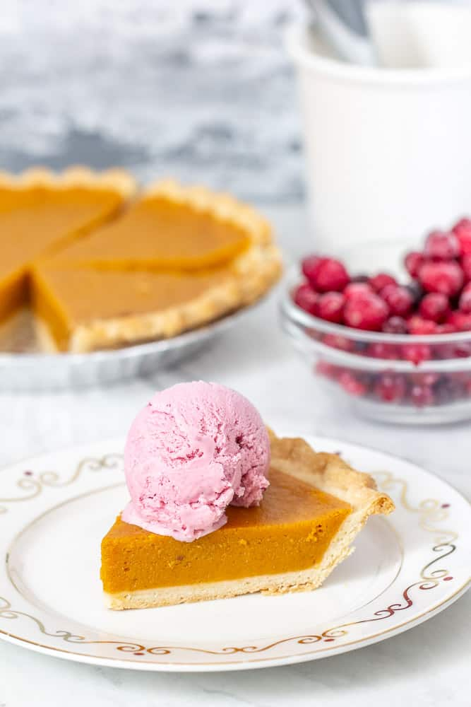 pumpkin pie, cranberries, and slice of pie with ice cream on top, vertical