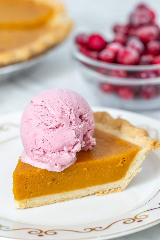 pumpkin pie with cranberry ice cream on top
