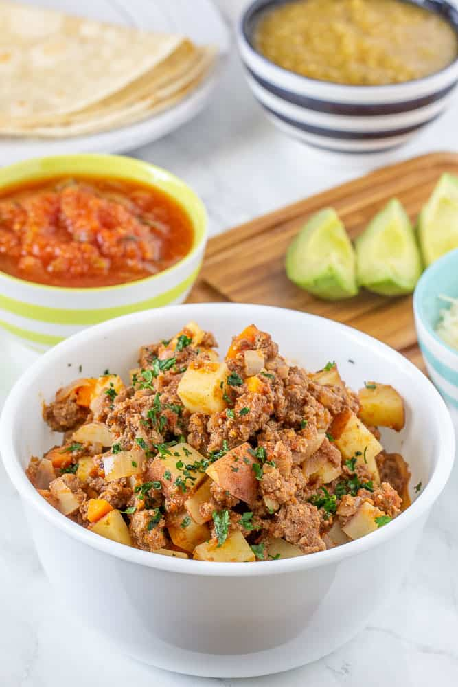 Ground bison picadillo in bowl vertical