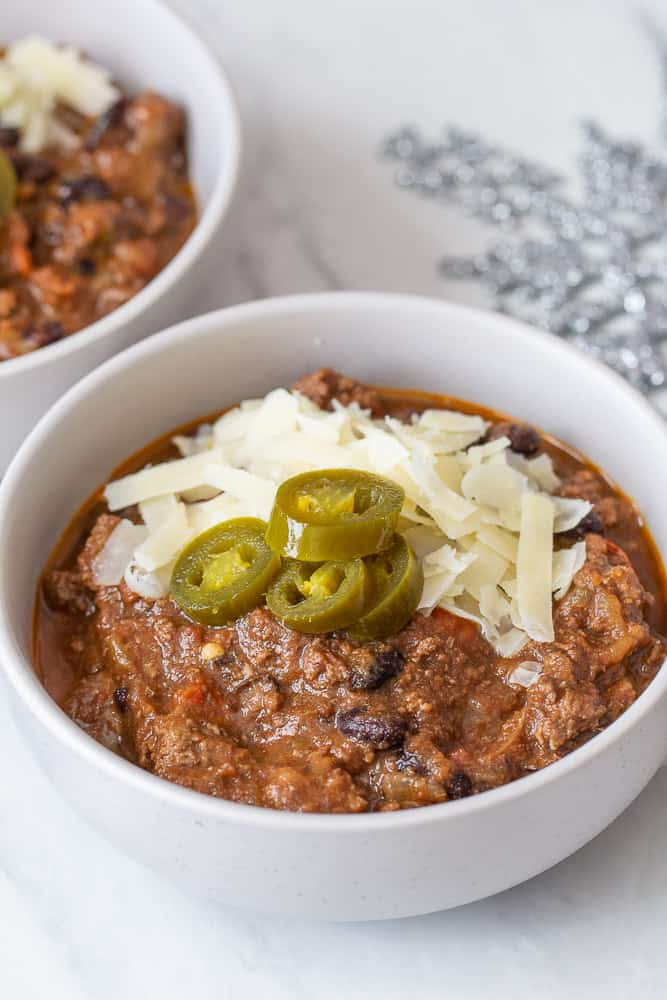 beef chili close up with cheese and jalapenos