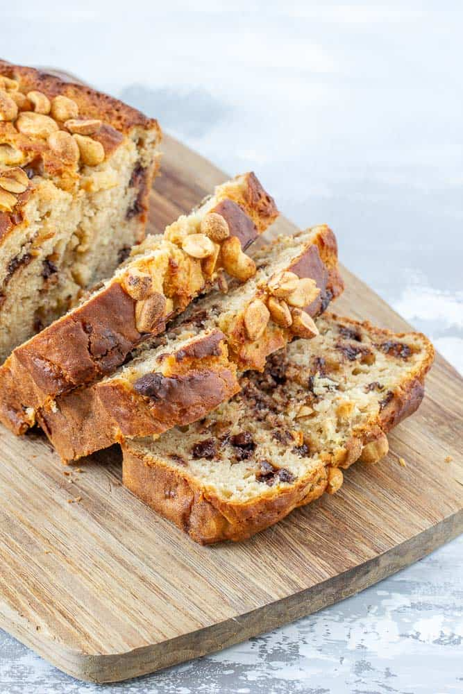 sliced banana bread with chocolate. chips and nuts on top