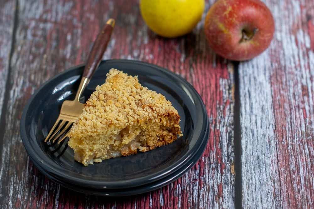 slice of apple coffee cake on a plate with a fork