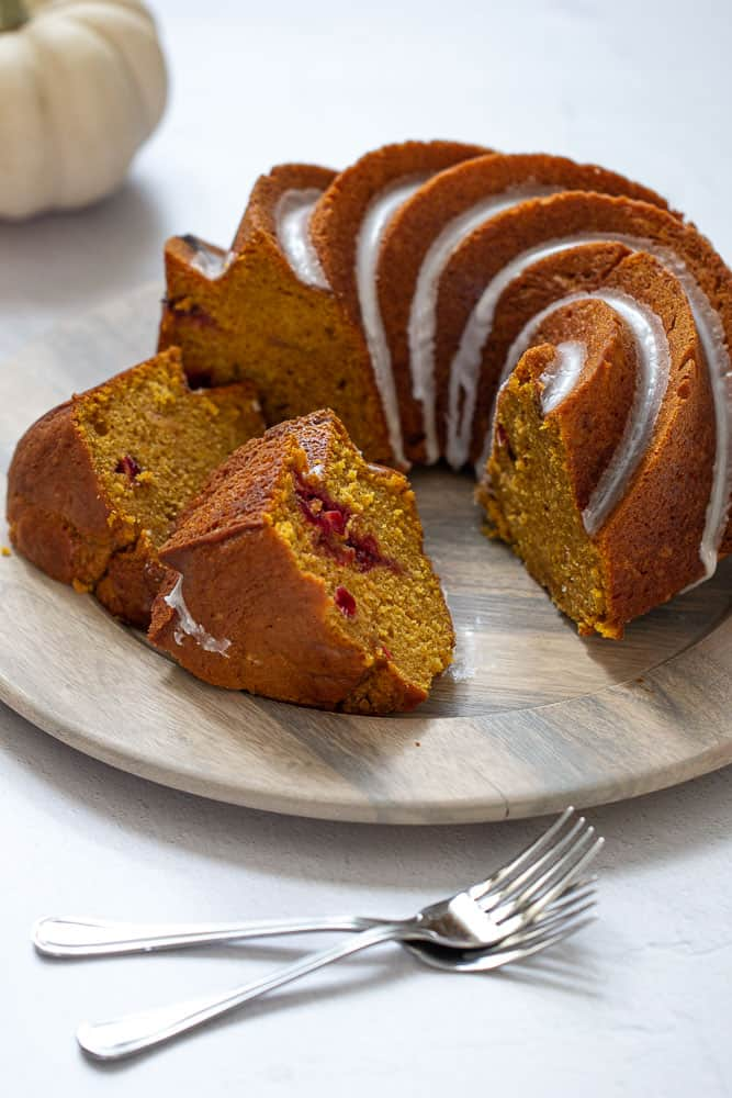 Sliced pumpkin bundt cake with cranberry swirl visible