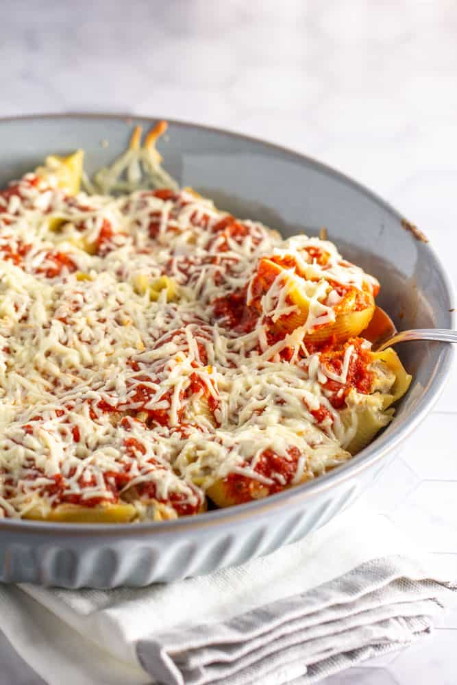 baking dish filled with stuffed shells covered in melted cheese