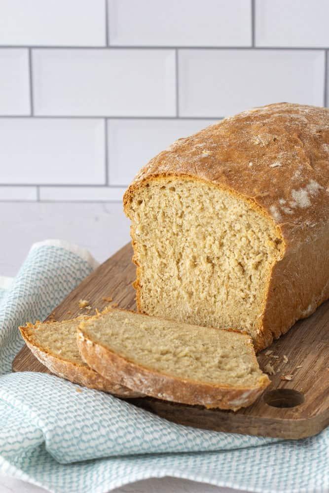 sliced honey oatmeal bread on a cutting board