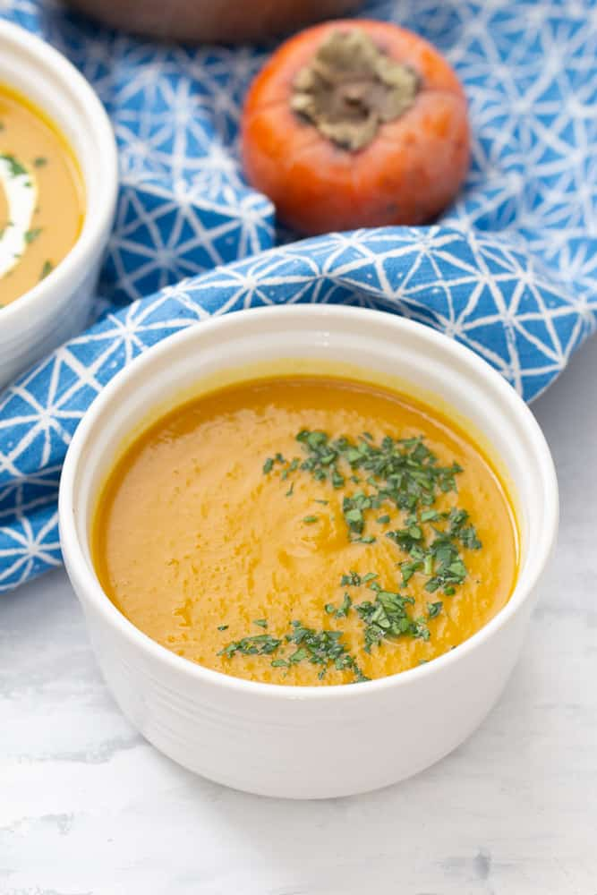 persimmon sweet potato soup with chopped parsley