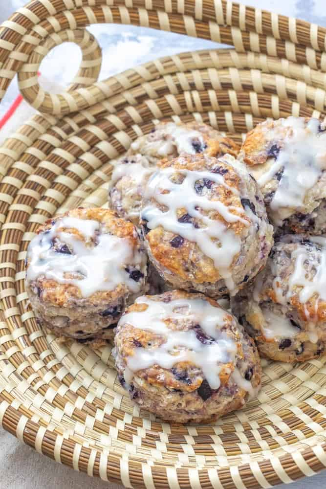 blueberry biscuits with icing in a sweetgrass basket