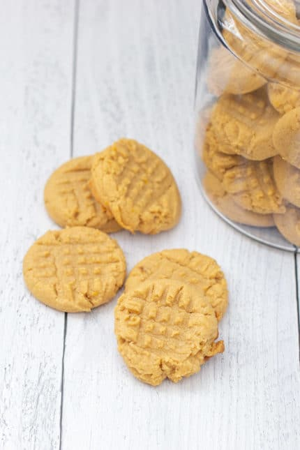 stacked peanut butter cookies on white board
