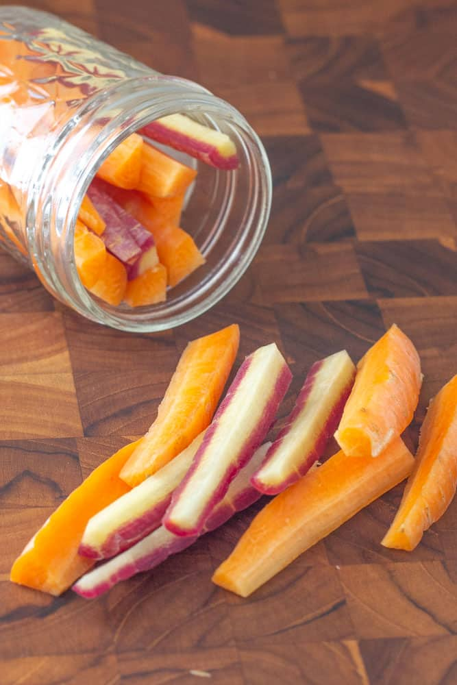 sliced carrots on a cutting board