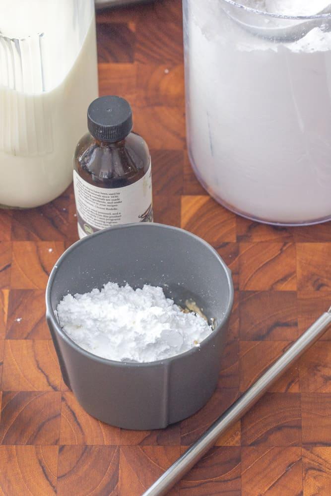 powdered sugar in a small gray bowl