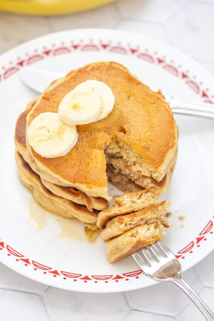 banana bread pancakes with a fork into cut pieces of pancake