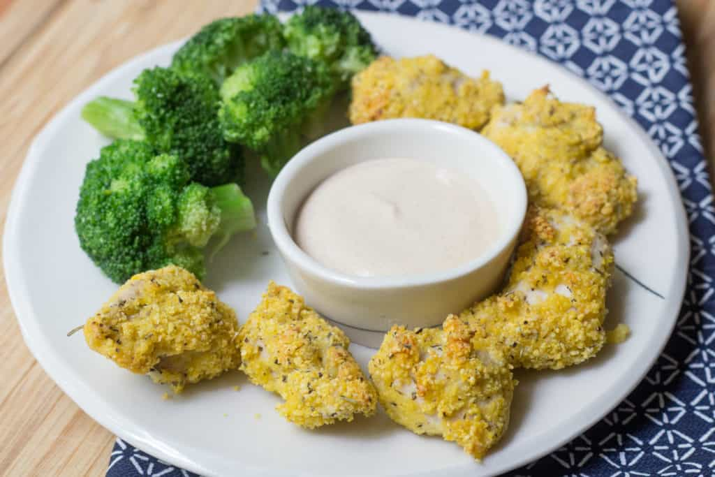 turkey nuggets with broccoli and dipping sauce on a plate