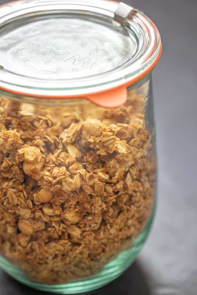close up of granola in a glass jar