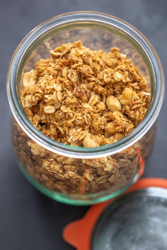 overhead peanut butter granola in a glass jar