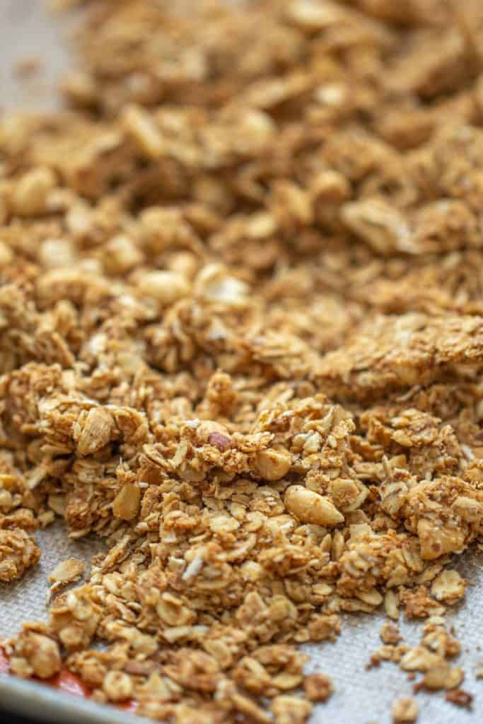 close up of baked granola on a sheet pan
