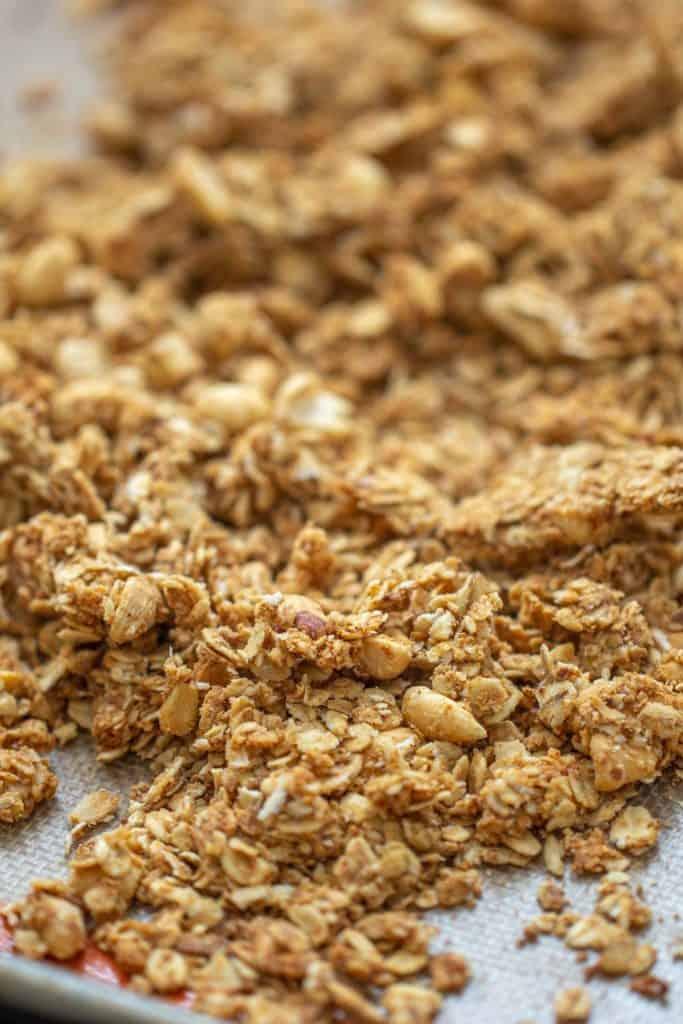 close up of baked granola on a sheet pan