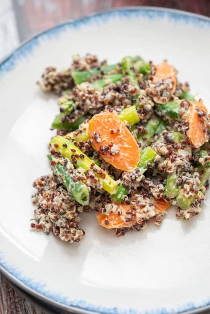 close up of quinoa primavera on a blue-edged white plate
