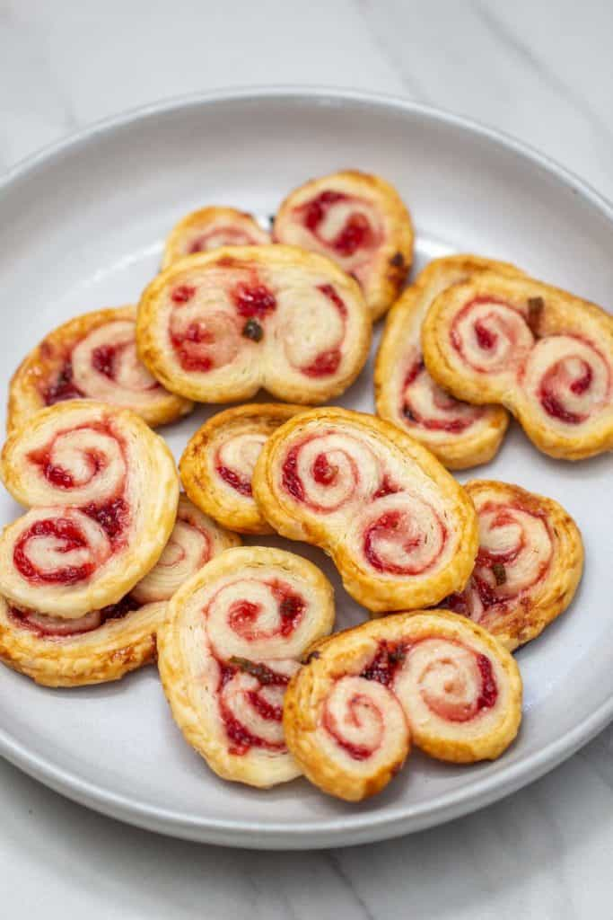 strawberry jalapeno palmiers on a gray plate