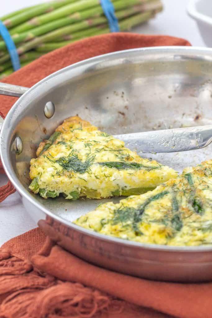 sliced asparagus dill frittata in saute pan