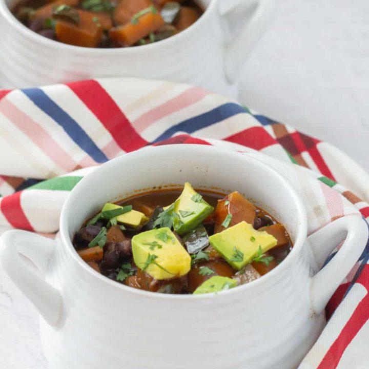 sweet potato black bean chili in white soup bowls