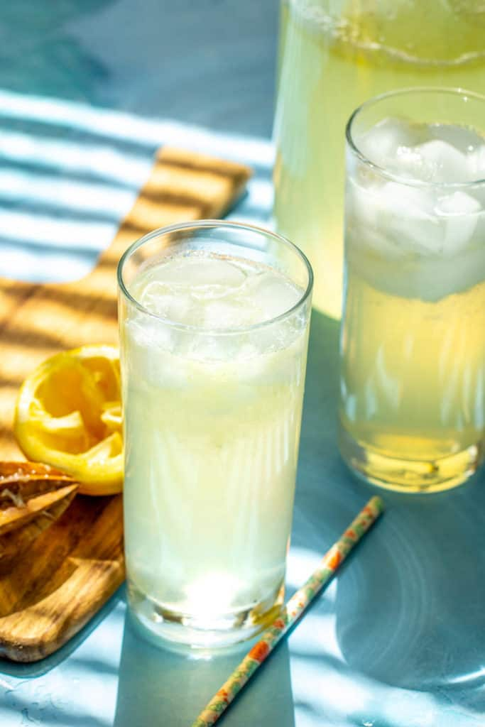 glasses of lemonade on blue surface