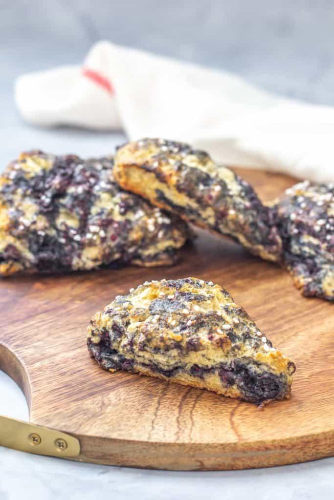 black raspberry scones on wooden tray