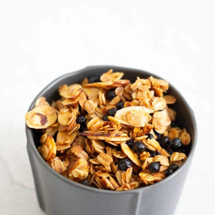gray bowl filled with lemon blueberry granola