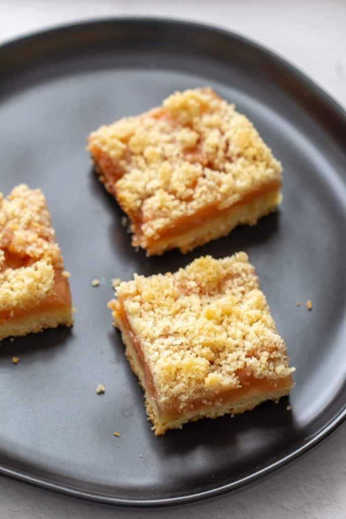 black plate with three apple pie bars