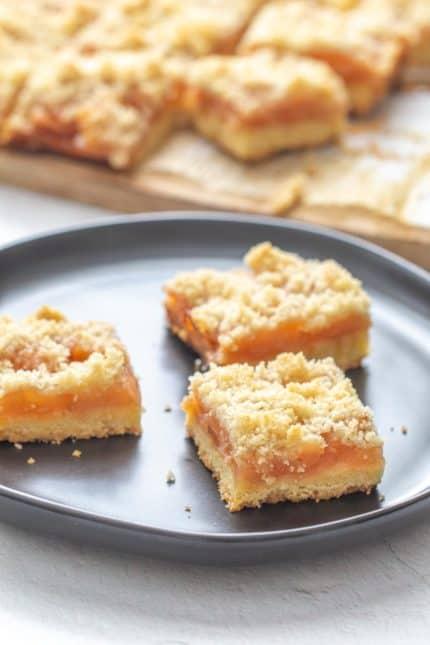 apple pie bars on a black plate