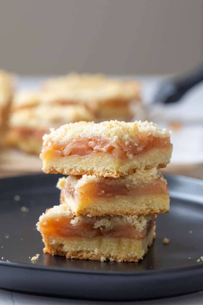 stacked apple pie bars on black plate