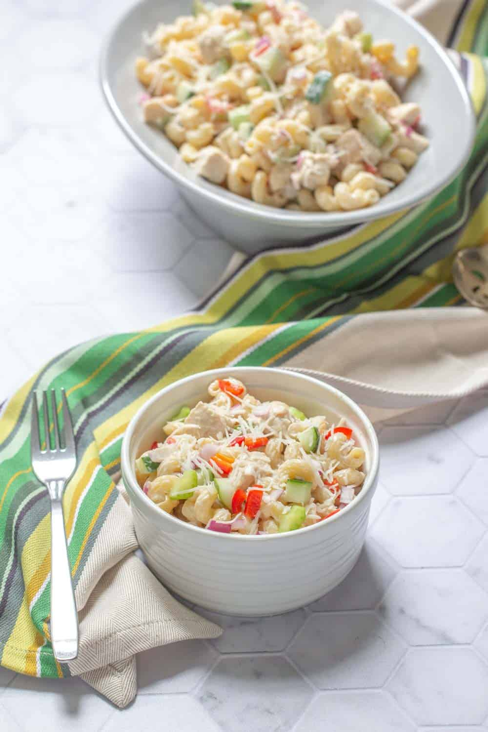 bowl of chicken pasta salad with serving dish behind