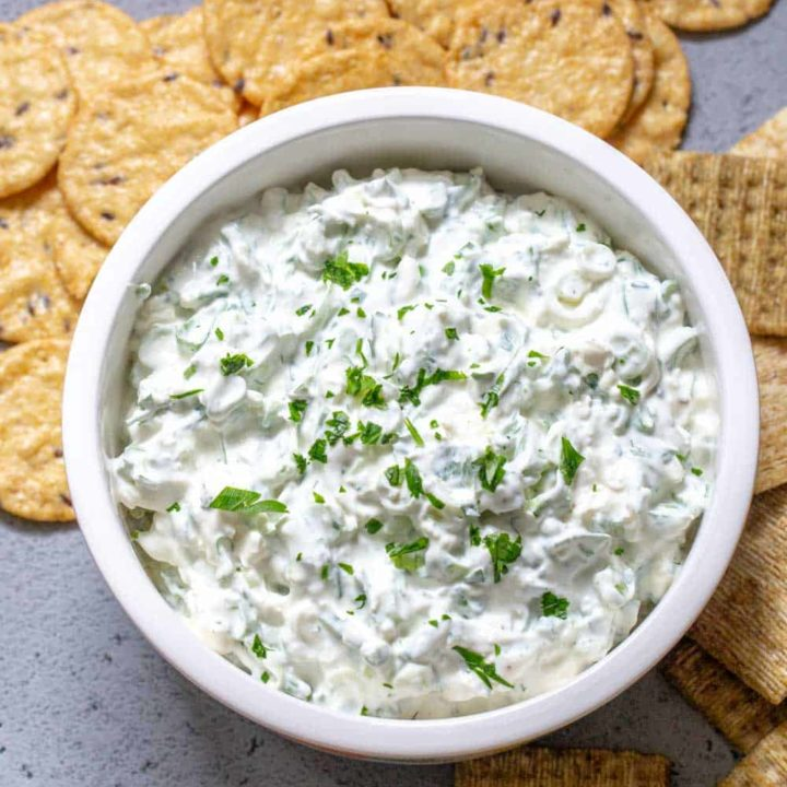 overhead of green onion dip in a bowl