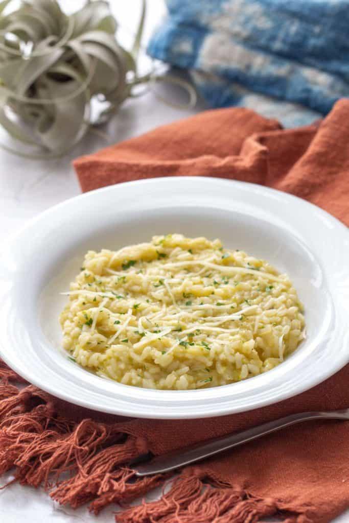 zucchini risotto in a white bowl