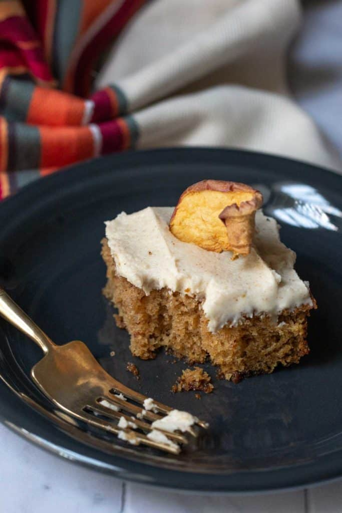 slice of apple spice cake with a bite taken out