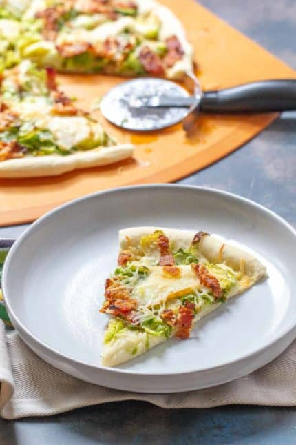 slice of brussels sprouts pizza on a plate