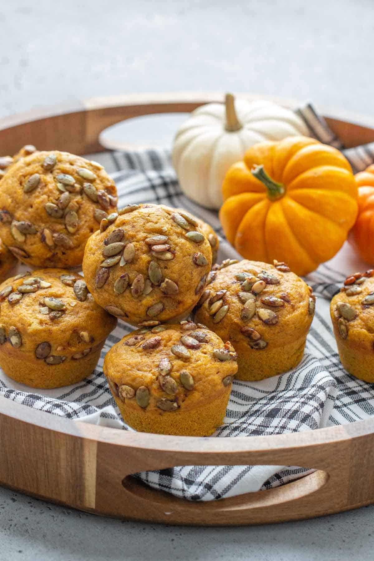 tray of pumpkin muffins with a plaid napkin