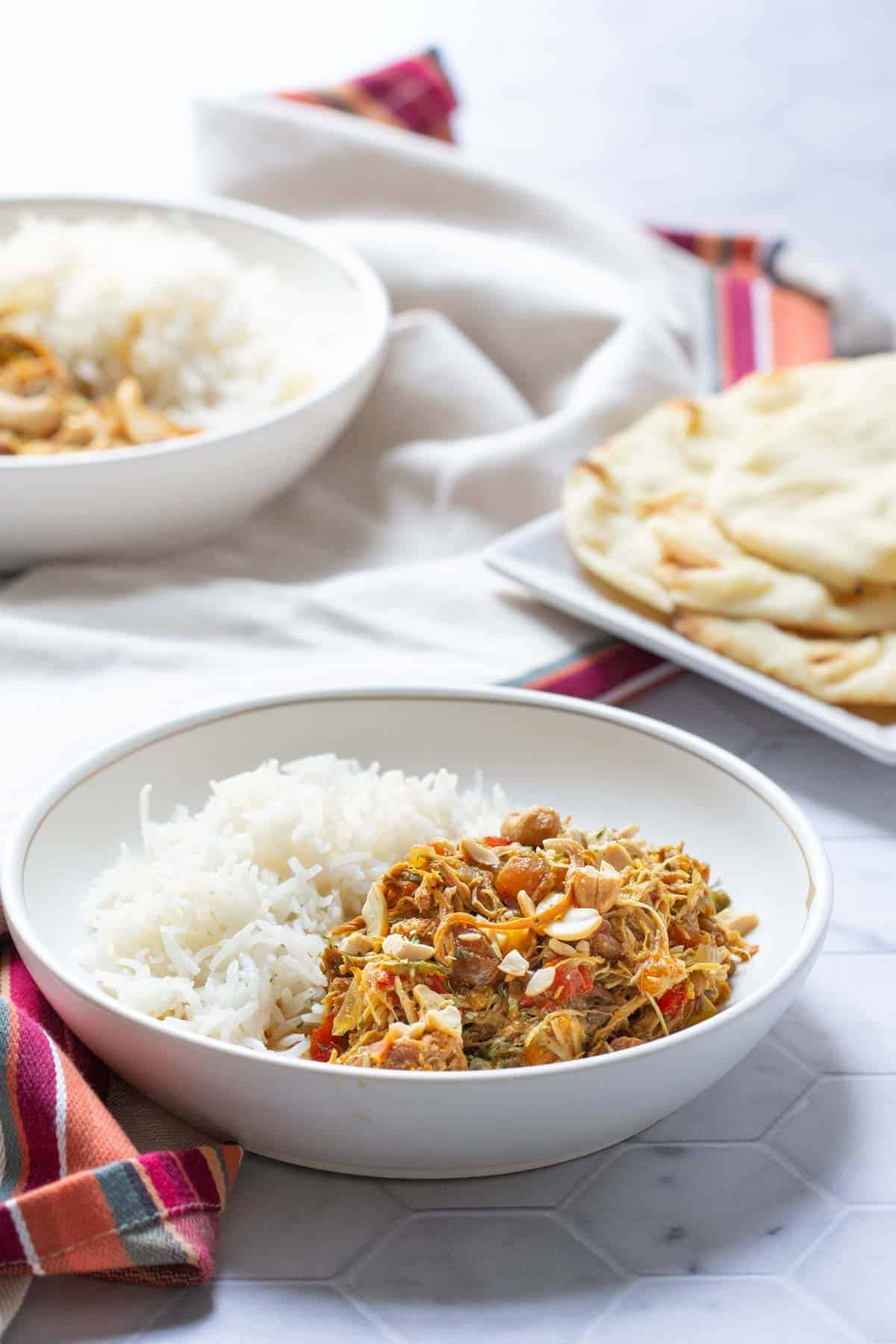 bowls of curried chicken and rice