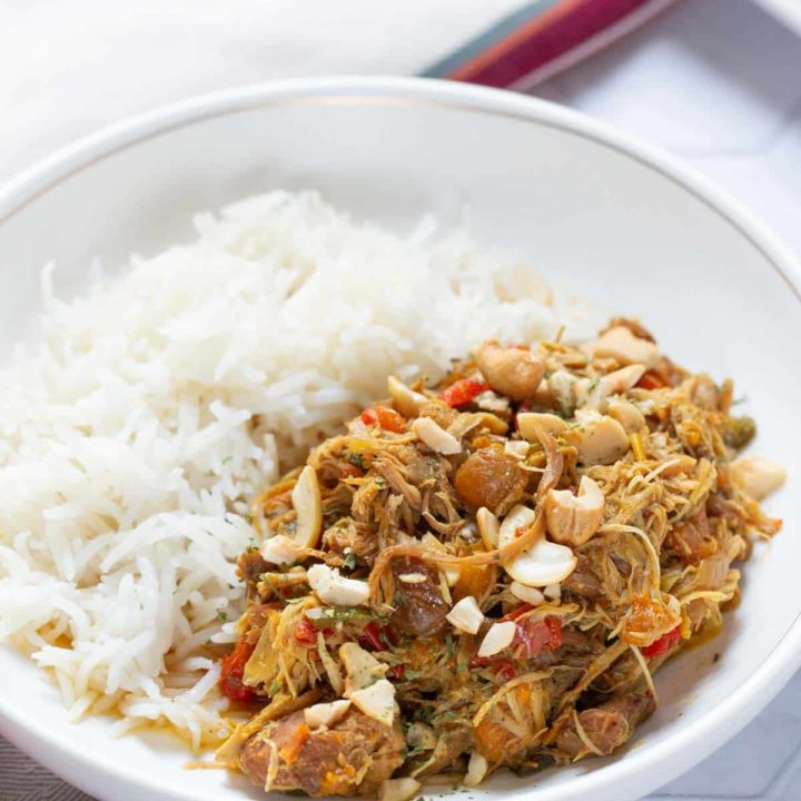 rice and curried chicken in a bowl