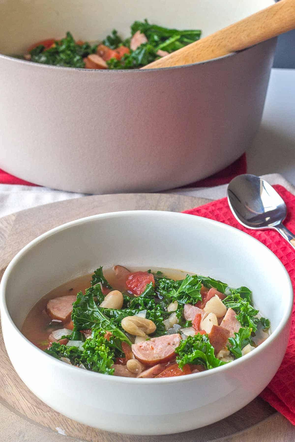 white bowl of white bean sausage soup