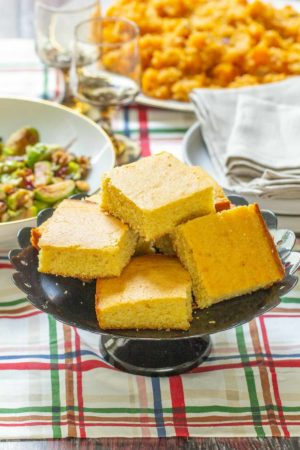 plate of buttermilk cornbread on holiday table