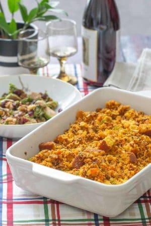 chorizo cornbread stuffing in baking dish on holiday table