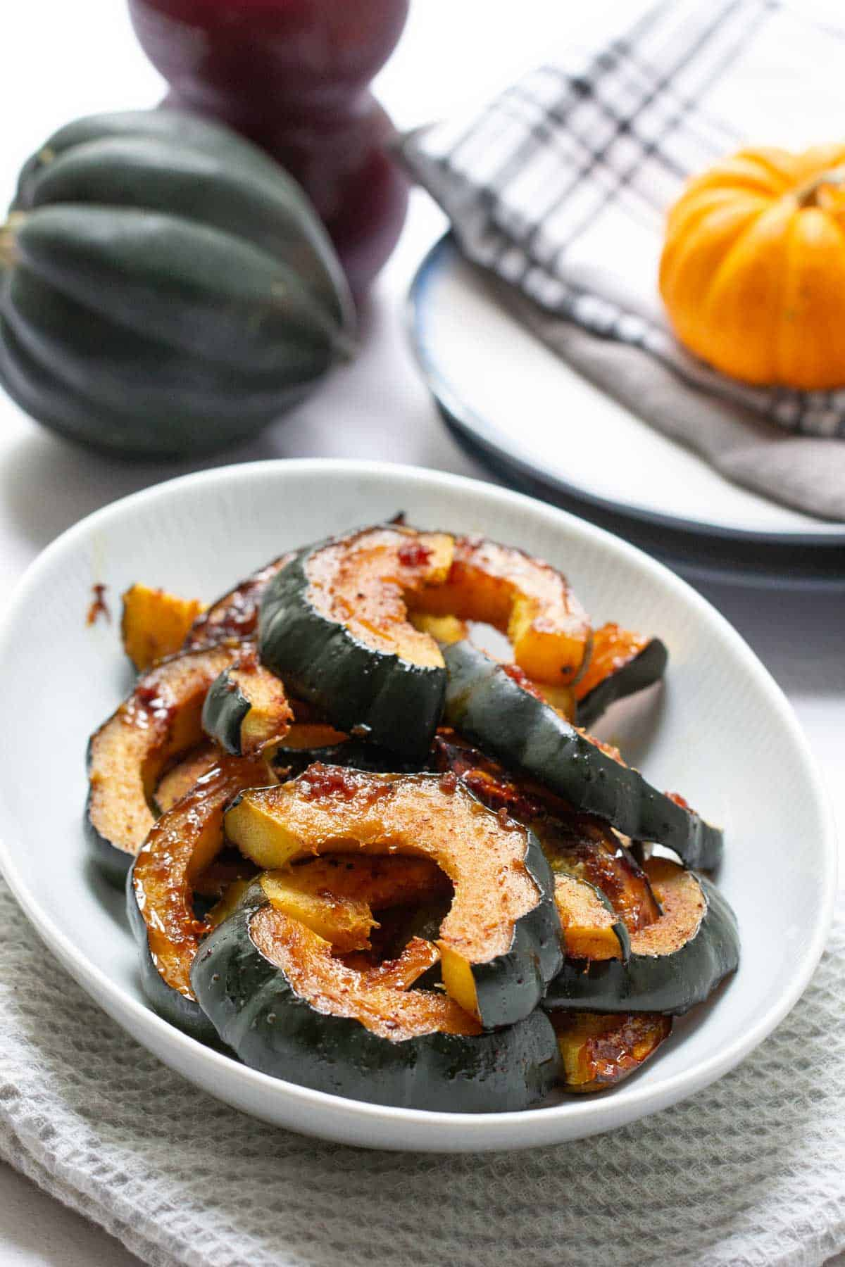 glazed acorn squash in a serving dish